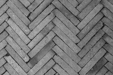 Hoogste meningstextuur van grijs blok in concrete grond van stoep. (Zwart en wit filtereffect) Stockfoto