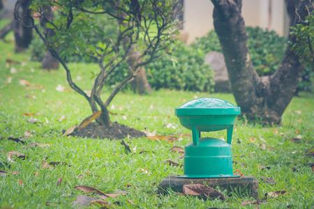 Green garden lamp for outdoor on green grass in public park.