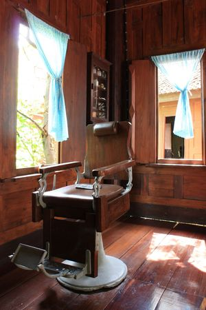 Antique barber chair photo