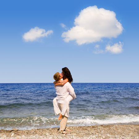 Young attractive couple kisses on the beach Stock Photo - 2443122
