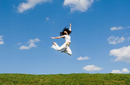 happy young woman is jumpingr photo
