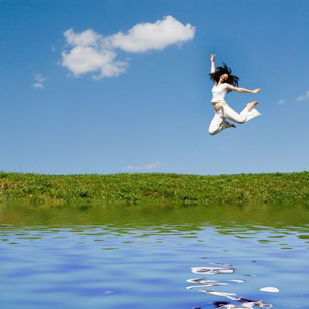 happy young woman is jumping Stock Photo - 2837875