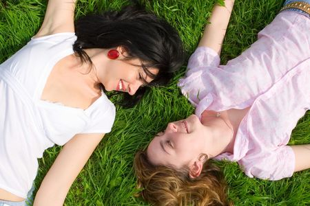 smiling women rest on the green grass Stock Photo - 3149657