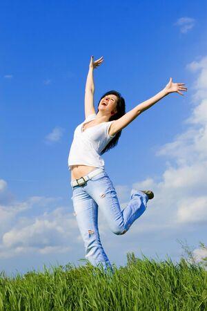 expressive woman dancing on green grass