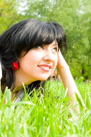 pretty woman rest on the green grass Stock Photo - 3217559