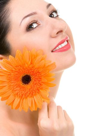 Young woman with gerber flower isolated over white background photo