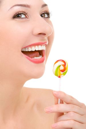 pretty woman licking candy on white background  photo