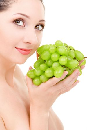 pretty woman with green grape isolated on the white background photo