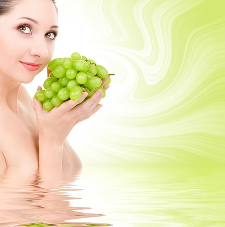 pretty woman with green grape isolated on the white background Stock Photo - 3699236