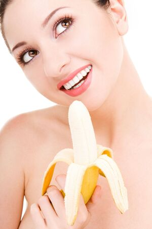 pretty woman with banana isolated on the white background photo