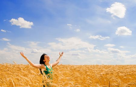 Happy woman in golden wheat Stock Photo - 3882095