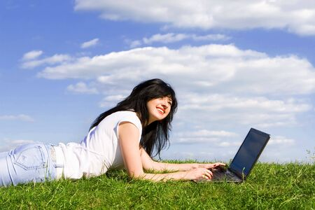pretty woman with laptop on the green grass Stock Photo - 3883795