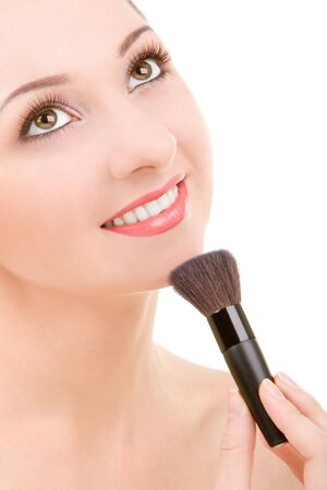 Pretty young woman with a make-up brush Stock Photo - 3883770