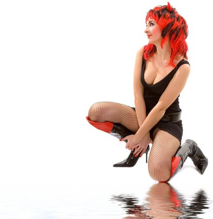 sexy devil woman isolated on the white background photo