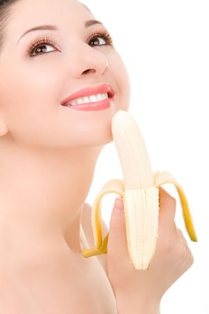 pretty woman with banana isolated on the white background