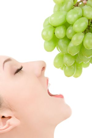 pretty woman with green grape isolated on the white background Stock Photo - 3896666