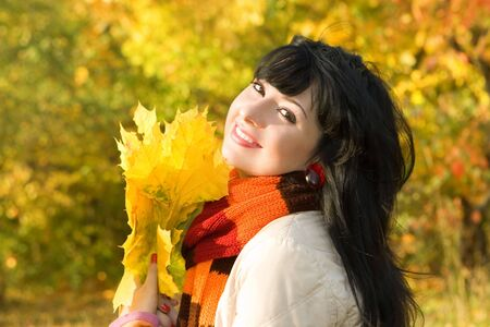 Young pretty woman in the autumn park photo