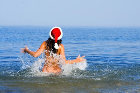 young sexy santa girl in the sea Stock Photo - 3950065