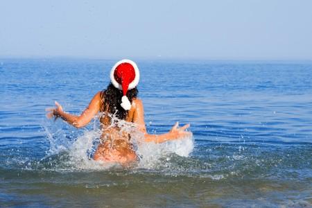 young sexy santa girl in the sea Stock Photo - 3950065