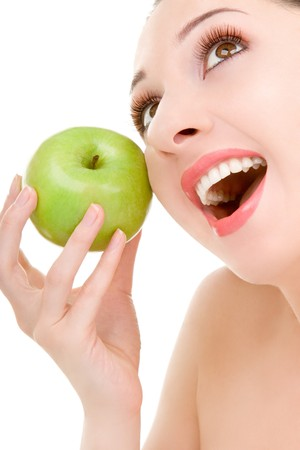 pretty woman with green apple isolated over white background Stock Photo - 4000450