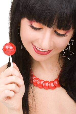 sweet woman with candy on white background photo