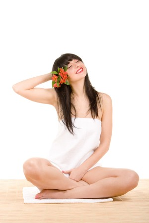 ly spa brunette with flowers photo