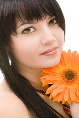 Young woman with orange flower photo