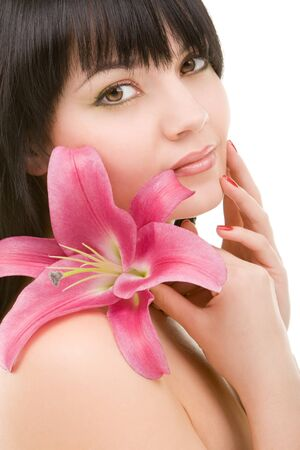 Young woman with lily flower photo