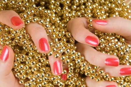 glitter makeup: decoraci�n en mano femenina