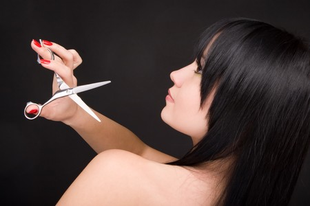 Lovely brunette with scissors of the hairdresser Stock Photo - 4206644