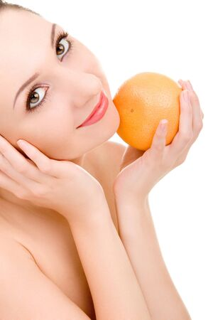 pretty woman with orange isolated on the white background Stock Photo - 4244049