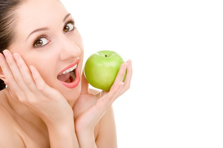 virgin girl: pretty woman with green apple isolated over white background