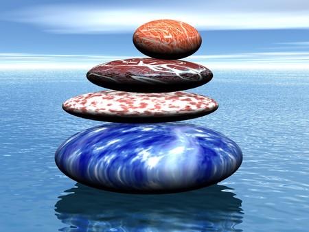 Stack of balanced stones on the sea  photo