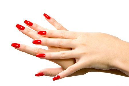 women subtle: Woman hand with red nails isolated in white background