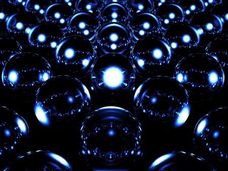 Glass sphere illuminates other spheres photo