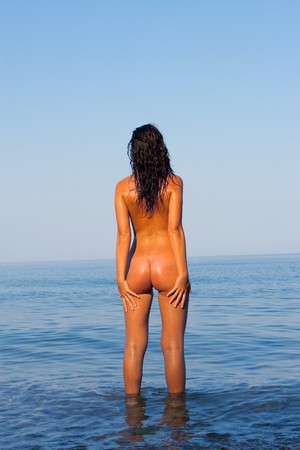 naked women body: Pretty young woman on the sea