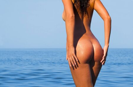 Pretty young woman on the sea Stock Photo - 4490785