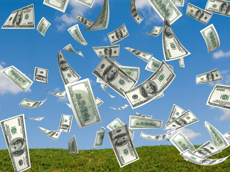 winning money: money falling in the sky and green grass background