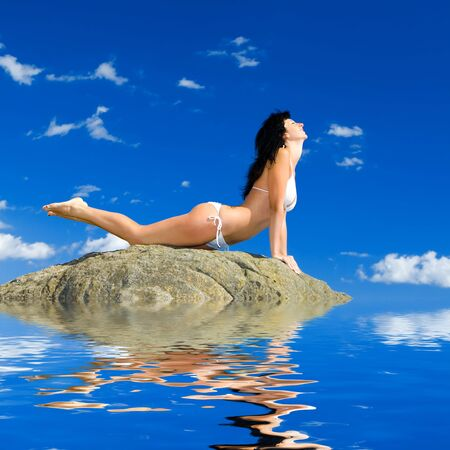 pretty woman relaxation in the beach photo