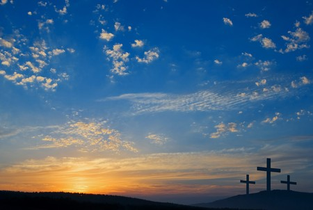 easter morning: three crucifixions on the hill  Stock Photo