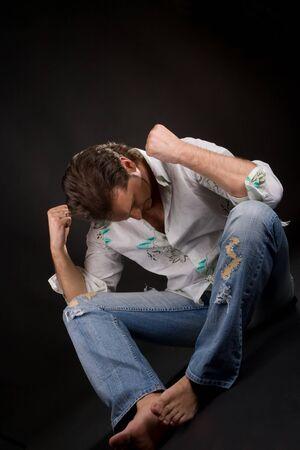 emotional man on the dark background photo