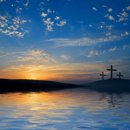 easter sunrise: three crucifixions on the hill  Stock Photo