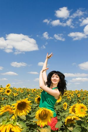 fun woman dance in the field of sunflowers Stock Photo - 4766650