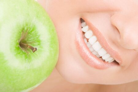 lips smile: healthy teeth and green apple  Stock Photo