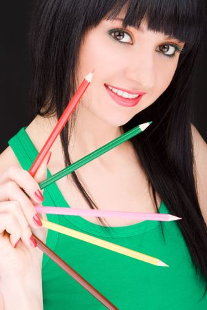young woman with varicolored pencils photo