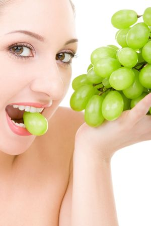 pretty woman with green grape isolated on the white background Stock Photo - 4926296