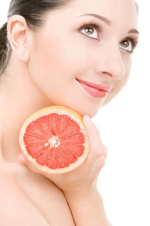 pretty woman with orange isolated on the white background Stock Photo - 4926250