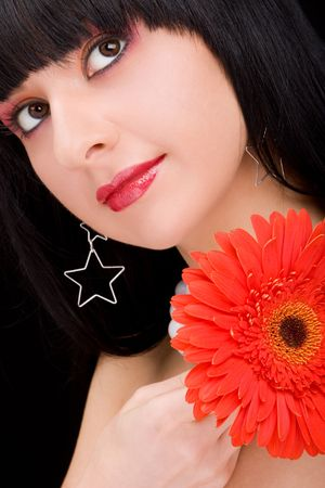 Young woman with red flower  photo
