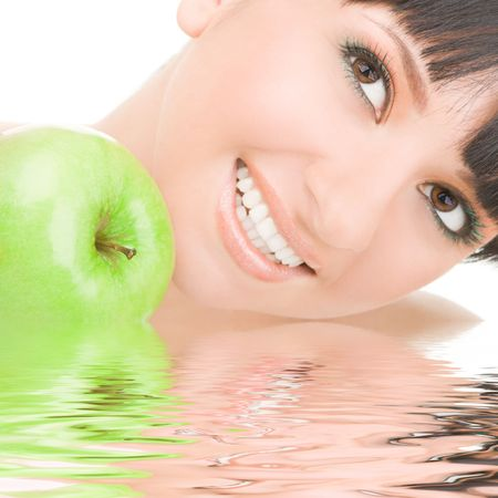 sweet girl eating green apple on white background Stock Photo - 5015513