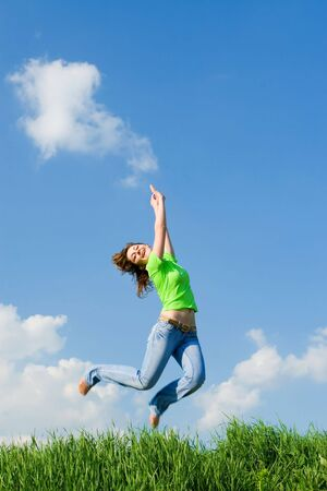 pretty young woman is jumping  photo